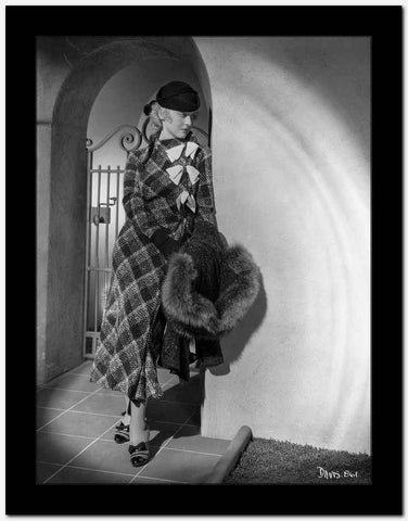 Bette Davis Leaning on the Corner Holding a Black Fur Boa in Black Hat and Tartan Long Sleeve Dress High Quality Photo