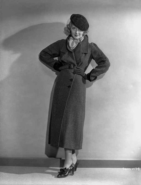 Bette Davis Posed with Hands on the Back in Black Wool Cap and Trench coat with Black Shoes Premium Art Print