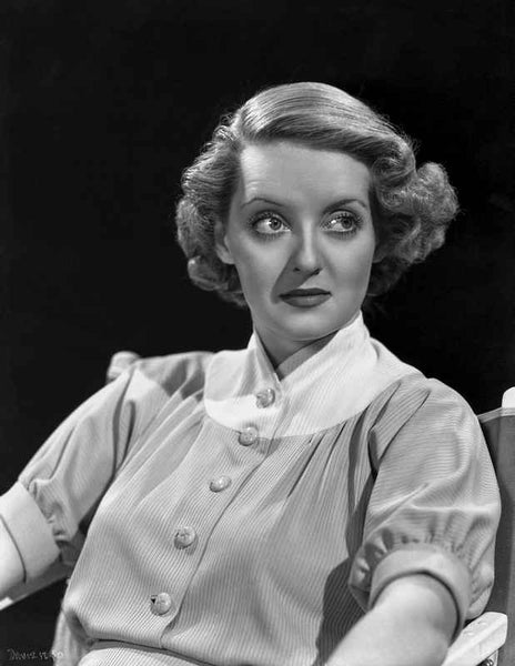 Bette Davis Seated while Looking to the Left in White High Neck Folded Short Sleeves Shirt Premium Art Print