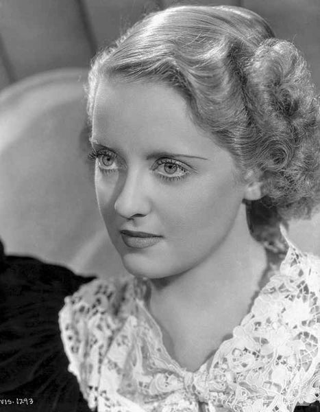 Bette Davis Portrait Looking Straight in Black Dress and White Broad Lace Collar Premium Art Print