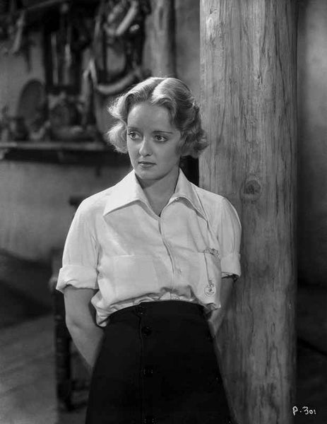 Bette Davis Posed Hands on the Back in Whir Collar Shirt with Sleeves Rolled Up and High Waist Long Skirt Premium Art Print