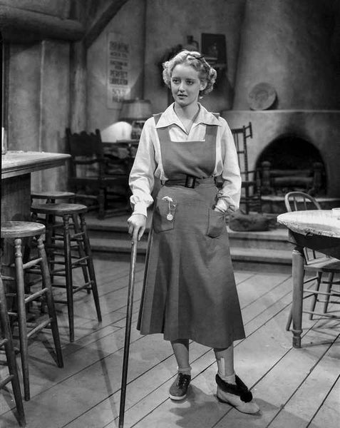 Bette Davis Posed with Hand on the Pocket and Walking Stick in White Long Sleeve Shirt and Apron Premium Art Print