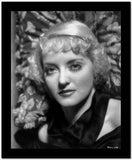 Bette Davis Portrait Highlighted Face in Black Halter Dress with Short Curls on Floral Background High Quality Photo