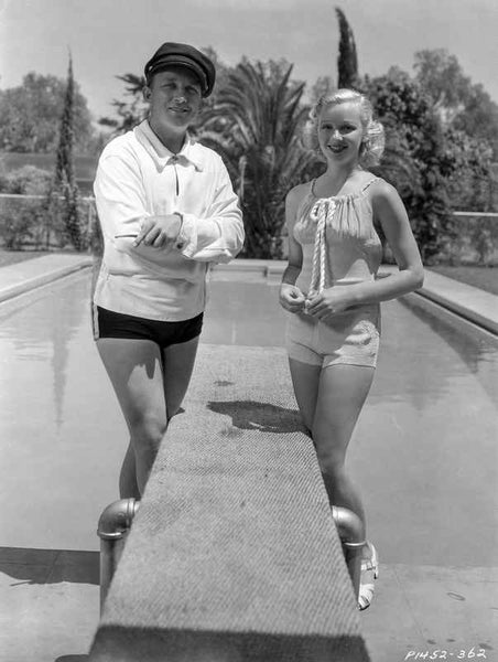 Bing Crosby standing with Woman in Jogging Wear Premium Art Print