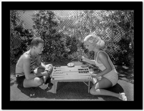 Joan Crawford Playing with a Guy in the Table High Quality Photo