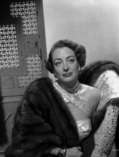 Joan Crawford Looking Away From the Camera while Leaning on a Chair in Classic Premium Art Print