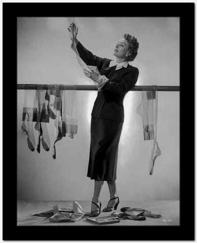 Joan Crawford Holding Her Stockings in a Classic Portrait High Quality Photo