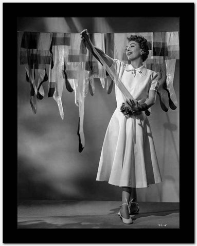 Joan Crawford Hanging Her Stockings in a Classic Portrait High Quality Photo