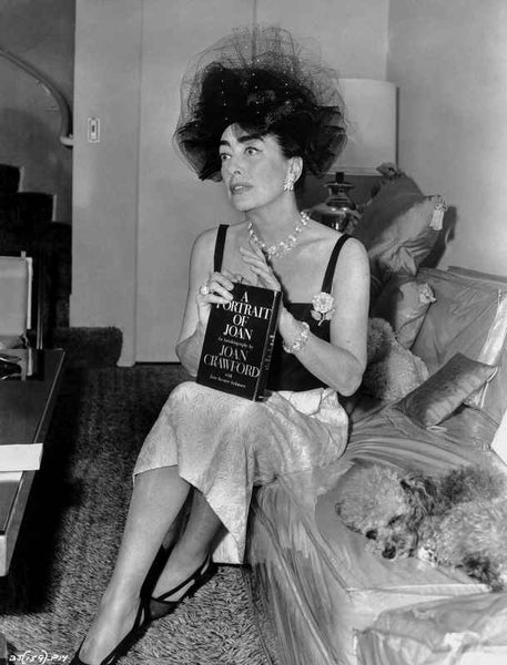 Joan Crawford sitting on the Sofa and Holding a Book in Classic Premium Art Print