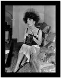Joan Crawford sitting on the Sofa and Holding a Book in Classic High Quality Photo