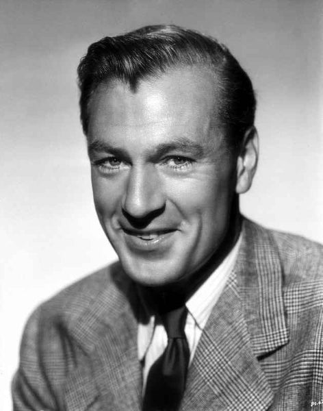 Gary Cooper smiling in Suit with Gray Background Premium Art Print