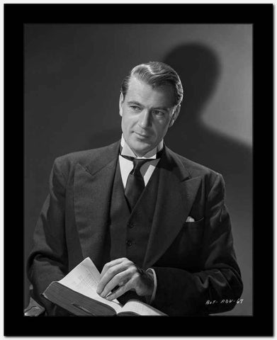Gary Cooper Opening a Page in a Book High Quality Photo
