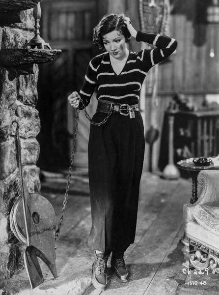 Claudette Colbert standing in Stripes Sweater with Black Pants Premium Art Print