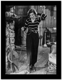 Claudette Colbert standing in Stripes Sweater with Black Pants High Quality Photo