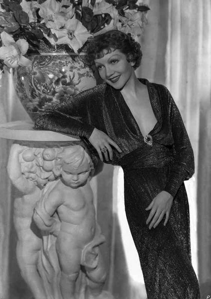 Claudette Colbert Leaning on Statue, wearing Black Dress Premium Art Print