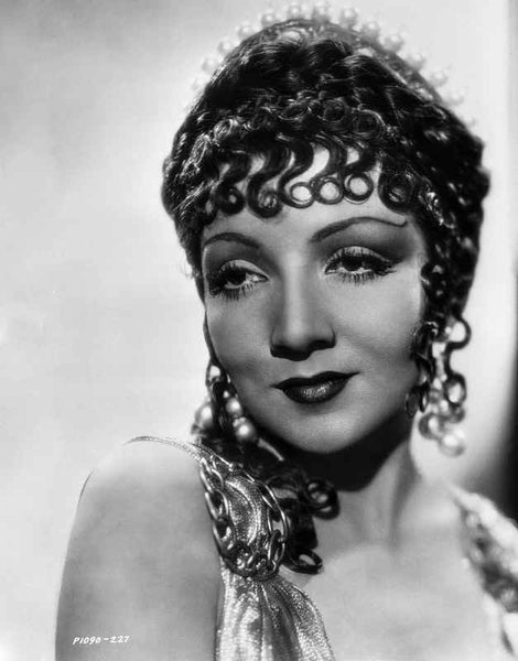 Claudette Colbert smiling in Close Up Portrait with Headdress Premium Art Print