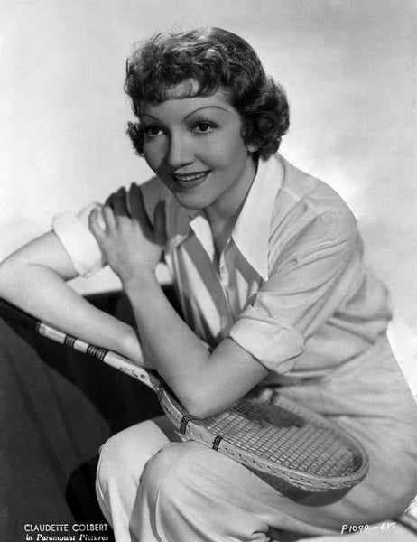 Claudette Colbert Posed in White Shirt with Tennis Racket Premium Art Print