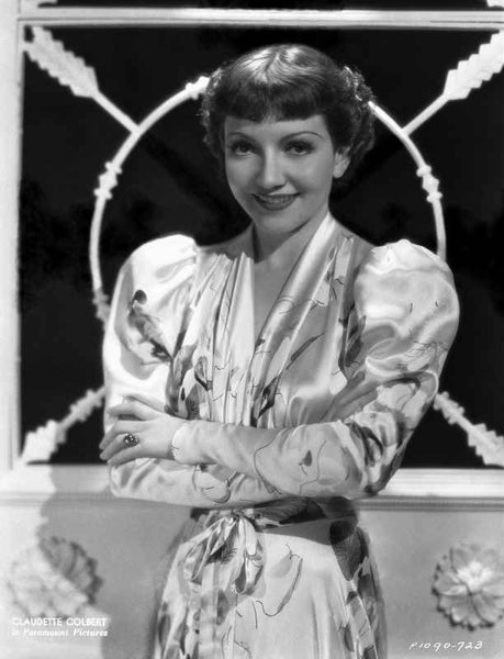 Claudette Colbert smiling in Floral Dress with Arm's Cross Premium Art Print
