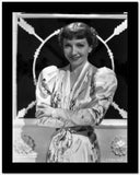 Claudette Colbert smiling in Floral Dress with Arm's Cross High Quality Photo