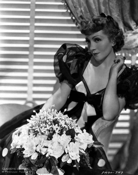 Claudette Colbert sitting in Black Elegant Dress with Flowers Premium Art Print
