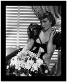 Claudette Colbert sitting in Black Elegant Dress with Flowers High Quality Photo