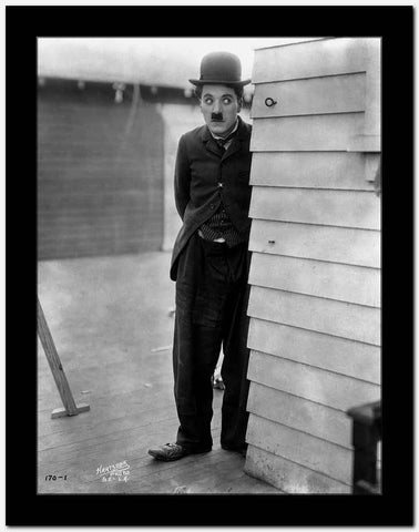 Charlie Chaplin Sneaking in Black Suit High Quality Photo