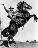 James Cagney Rode on a Black Horse in Long Sleeve Coat and Cowboy Hat with Right Hands Raise Up Premium Art Print