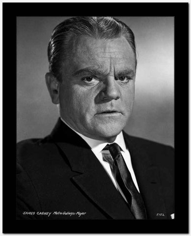 James Cagney Portrait Looking Serious in Black Velvet Suit and Black Silk Necktie with White Collar Shirt and Brushed Up Hair on Grey Background High Quality Photo