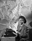 James Cagney Seated on a Chair In front of a Typewriter in Round Hat and Grey Suit with Hands Holding a Paper Premium Art Print