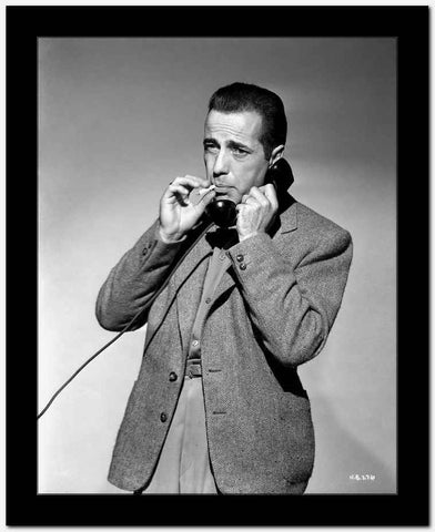 Humphrey Bogart on telephone smoking High Quality Photo