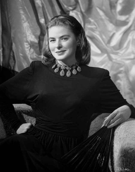 Ingrid Bergman smiling and sitting in a Long Sleeve Blouse Premium Art Print