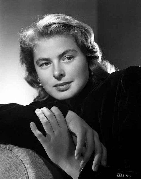 Ingrid Bergman sitting and Leaning on a Couch in a Black Long Sleeve Polo Premium Art Print