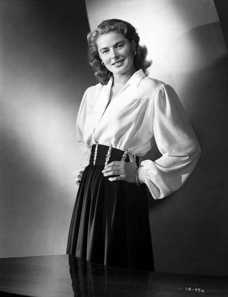 Ingrid Bergman wearing a Long Sleeve Blouse with Hands on Waist Premium Art Print