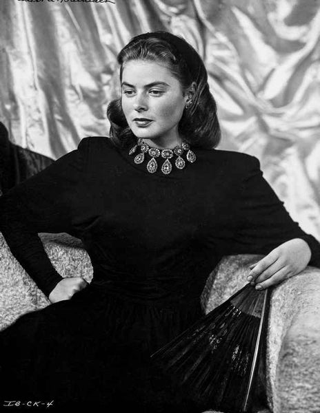 Ingrid Bergman sitting on a Couch in Black Dress Premium Art Print