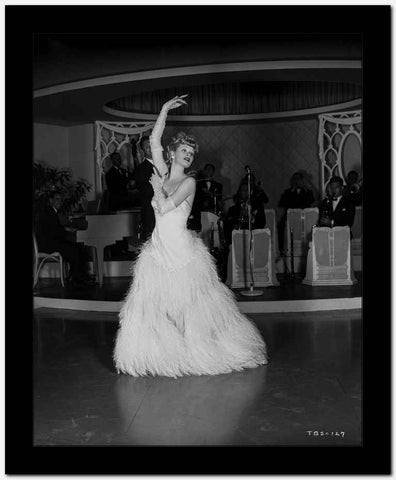 Lucille Ball Dancing in White Long Gown with One Hand Raise High Quality Photo