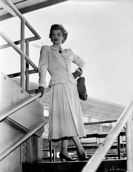 Lucille Ball standing on Stair, wearing White Dress Premium Art Print