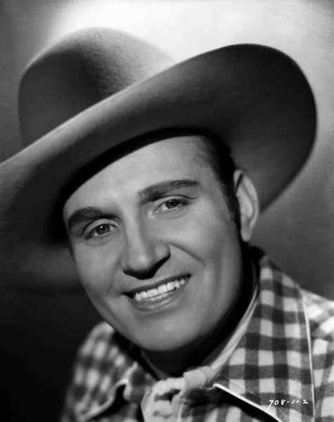 Gene Autry Grinning in Cowboy Attire Premium Art Print