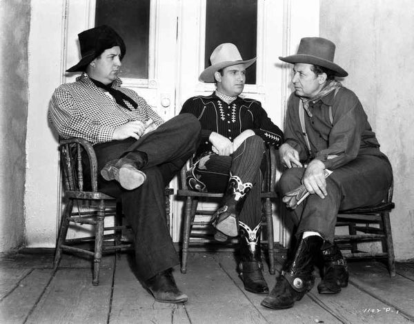 Gene Autry Seated on Chair with Two Men Premium Art Print