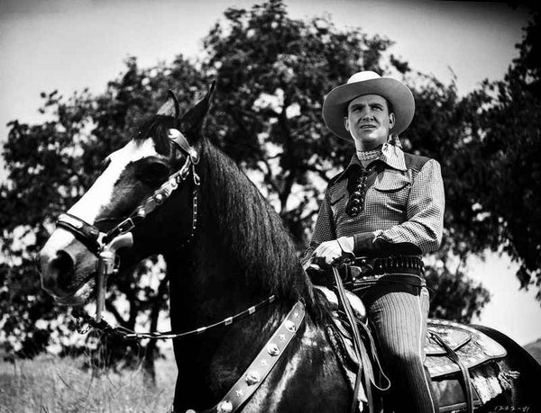 Gene Autry Riding a Horse with Trees on Background Premium Art Print