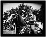 Gene Autry Riding a Horse with Trees on Background High Quality Photo