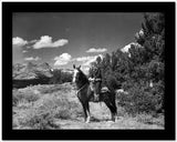 Gene Autry Riding a Horse in a Western Outfit High Quality Photo