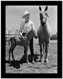 Gene Autry smiling with a Horse and Pony High Quality Photo