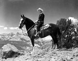 Gene Autry Riding a Horse in a Westerner Outfit Premium Art Print