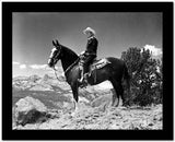 Gene Autry Riding a Horse in a Westerner Outfit High Quality Photo