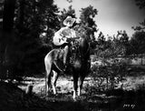Gene Autry Riding a Horse and Carying a Guitar Premium Art Print