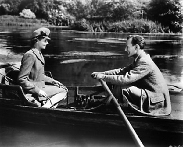 Brief Encounter Man Paddling a Boat with Lady in Coat Premium Art Print