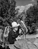 Gene Autry Hiding Behind a Big Rock Premium Art Print