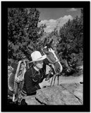 Gene Autry Hiding Behind a Big Rock High Quality Photo