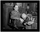 Gene Autry Seated on Chair with his Legs Crossed High Quality Photo