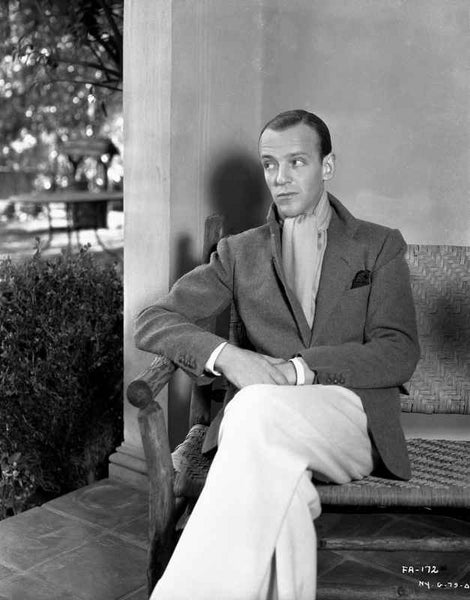 Fred Astaire Seated on Couch with Woman in Black Dress Premium Art Print